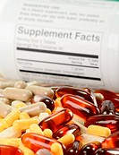 Composition with dietary supplement capsules