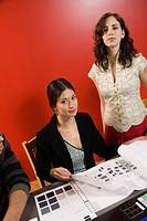 Women Looking at Samples
