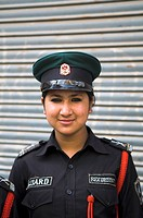 A Nepalese female security guard.