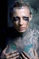Tattooed naked woman
