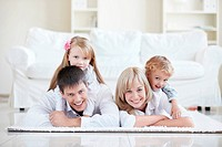 Merry parents with children at home
