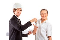 smiling engineer giving keys from apartment