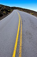 Dividing line on road going-up to crater on Haleakala volcano, Maui Island, Hawaii Islands, USA