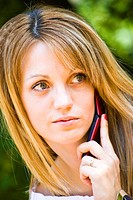 beautiful young woman talking on phone