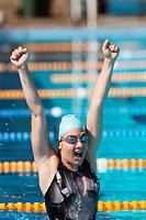 Young Woman Celebrating Success in Swimming Pool