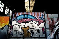 Graffiti on the exterior walls of an abandoned factory in Barcelona, ??photographed at dusk