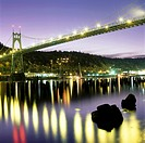 St  Johns Bridge and Willamette River at night, Cathedral Park, Portland, Oregon, United States