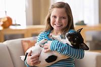Caucasian girl holding dog