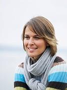 Germany, Munich, Mature woman near lake, smiling