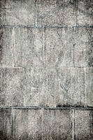Surface of old concrete wall covered with grey plates