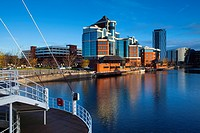 England, Greater Manchester, Salford Quays  Victoria Harbour building viewed from Detroit footbridge on the Manchester Ship Canal located in Salford
