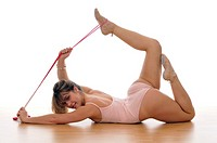 young woman doing exercise, gymnastics, with a rope
