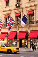 Taxi drives by Cartier Boutique on 5th Avenue in Manhattan, New York City USA