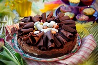 Chocolate torte with chocolate curls and sugar eggs