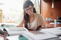 Portrait of smiling woman working at desk in office
