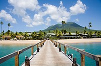 Stunning Pinney´s beach with Coconut Palms, and the Volcano in the distance, at Nevis  Caribbean