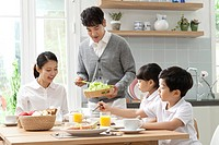 Father preparing breakfast for his family
