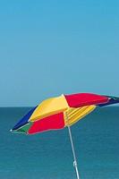 Colorful beach umbella on Venice Beach, Florida