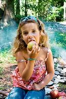 Little girl nature apple