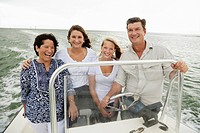 Smiling family boating outdoors