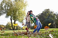 Germany, Cologne, Young couple in park, smiling, portrait