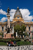 Plaza Murillo with pigeons, statue and Parliament Building, La Paz, Bolivia