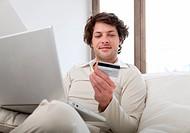 Man shopping online in living room