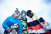 The people wearing the snowboarding wear with the snowboards