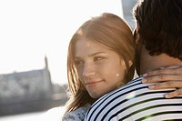 Germany, Cologne, Young couple hugging, smiling