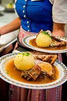Waitress with roast pork, Weltenburg, Bavaria, Germany, Europe