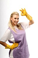 Portrait of cleaning girl showing that everything is OK