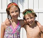Caucasian swimmers hugging