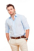 businessman in blue shirt and light trousers standing, looking _ isolated on white