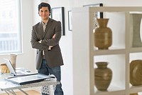 Portrait of man in his art gallery