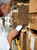 Warehouse worker scanning delivery