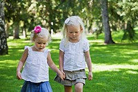 two sisters walking together in a park, edmonton alberta canada