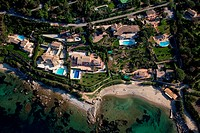 France, Var, St Tropez, the bay of Canebiers, villa with pool on the beach aerial view
