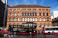 titanic and city open bus tours going past old richardson owden warehouse building donegall square north Belfast city centre Northern Ireland UK