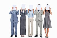 Five business people hiding their faces behind small placards