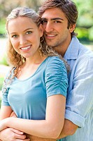 Cheerful couple hugging in the park