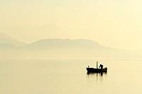 Fisherman on Lake Zug in the light of the setting sun, Canton of Zug, Switzerland, Europe