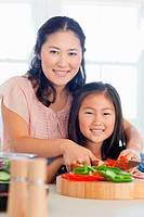 Close up of a mother and daughter preparing dinner