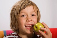 Boy, 6 years, eating a pear