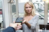 Hostess offering credit card machine