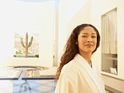 Hispanic woman in robe at resort