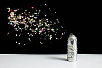 Floating confetti and a damaged spray paint can
