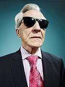 An elegant senior man wearing sunglasses