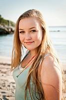 Spain, Mallorca, Teenage girl on beach, smiling, portrait