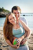 Spain, Mallorca, Couple on beach, smiling, portrait