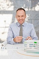 Germany, Leipzig, Businessman with architectural model